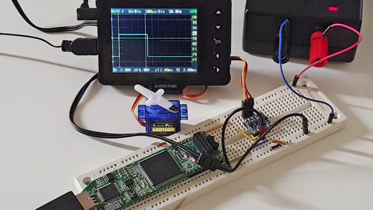 The Lattice iCEstick FPGA board controlling a TowerPro SG90 servo